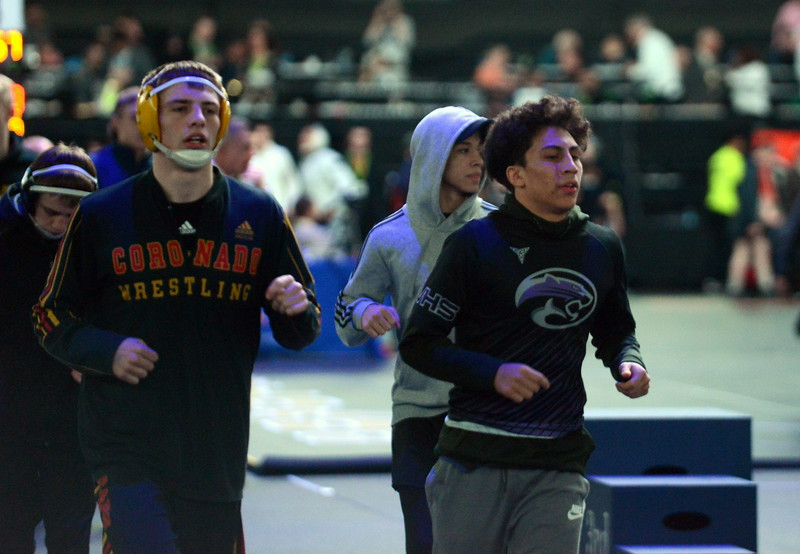 Mountain View's Malachi Contreras jogs around the mats to warm up for Saturday's finals of the Colorado State Wrestling Tournament at the Pepsi Center in Denver. (Mike Brohard/Loveland Reporter-Herald)