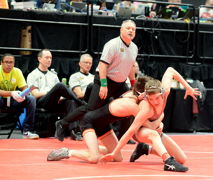 Cody Thompson makes his move on his way to scoring a reversal in his 12-4 major decision over Skylar Hunt of Lewis Palmer in their 4A 113-pound fifth-place match on Saturday at the state wrestling tournament at the Pepsi Center in Denver. (Mike Brohard/Loveland Reporter-Herald)