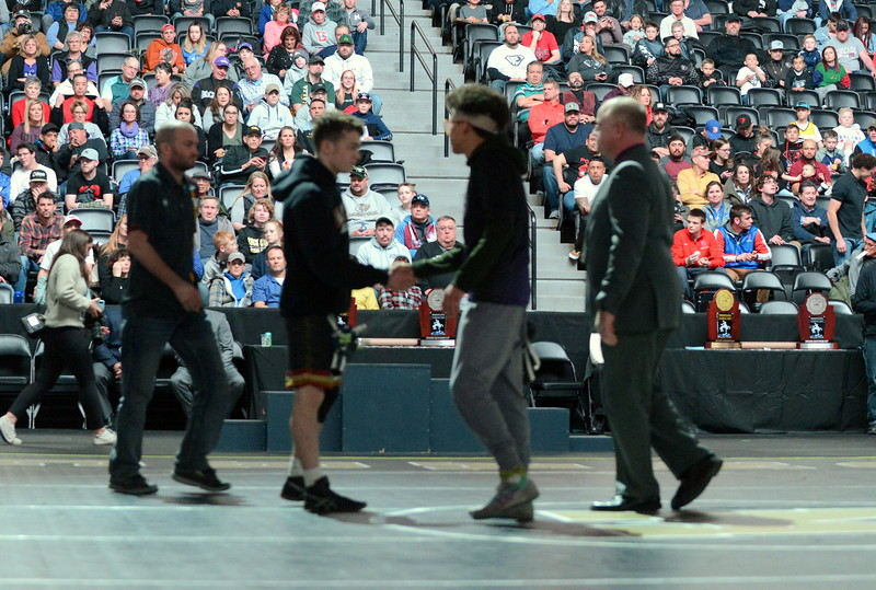 Malachi Contreras of Mountain View shakes hands with Windsor's Will Vombaur during introductions at Saturday's finals of the Colorado State Wrestling Tournament at the Pepsi Center in Denver. (Mike Brohard/Loveland Reporter-Herald)