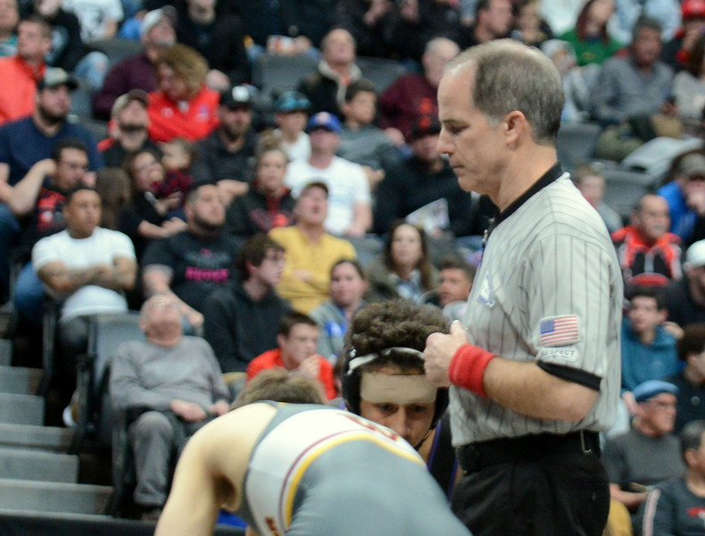Thompson Valley graduate Scott Tarbox was the lead official for the 4A 120-pound final between Mountain View's Malachi Contreras and Windsor's Will Vombaur at Saturday's finals of the Colorado State Wrestling Tournament at the Pepsi Center in Denver. (Mike Brohard/Loveland Reporter-Herald)