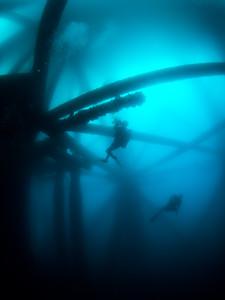 Divers beneath oil platform Ellen.