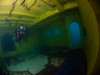 Dive buddy Sandra inside a yellow room of new artificial reef Uribe 121.