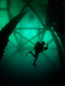 Dive buddy Felipe below oil platform Eureka.