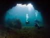Divers swim through the arch at Todos Santos.
