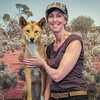 Kay patting a Dingo