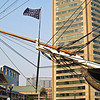 Closer look at the sailor on the bowsprit of the USS Constellation - he's getting ready to lower the jack of the United States, a maritime flag representing the US.  This particular jack is one that was used during the Civil War.