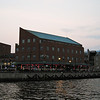 "View of ""Shuckers"" from the water taxi as we depart Fells Point.  Although there are many quaint restaurants in this neighborhood, this seems to be the only one overlooking the water.  Not much ambiance, but we enjoyed the crabcakes and the gentle breeze coming off the water."