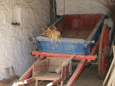The outbuildings are used to store carts and farming implements.