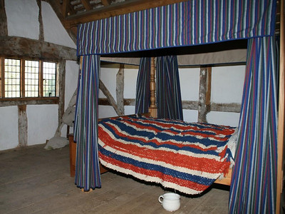 The master bedroom with its four-poster bed is in a separate room upstairs.  No en suite facilities; just a chamber pot.