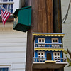 A closer look at two of the birdhouses adorning the light pole.