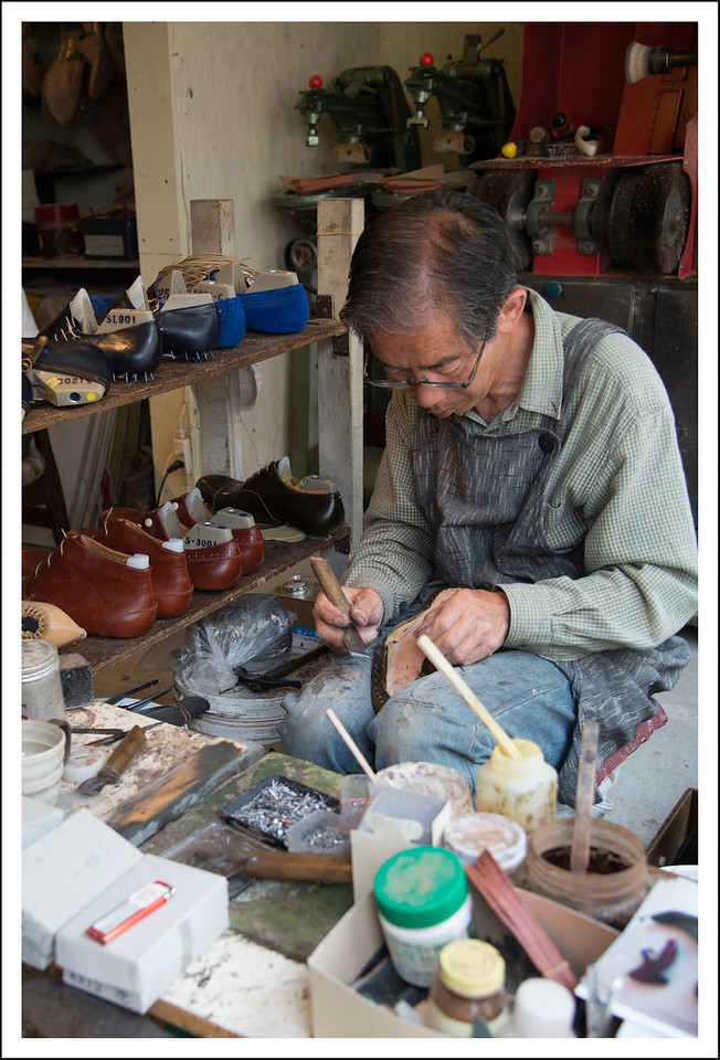 A shoe maker actually making shoes from scratch.  I wonder how expensive they were.