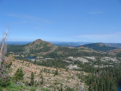 Haystack Mountain (middle left) ... Snow-capped Mount Lassen is barely visible on the horizon.