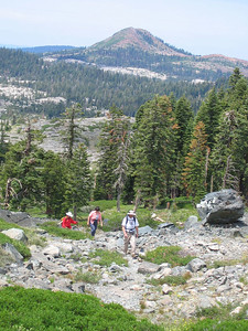 Jerry, Sheila, and Kris are climbing toward Glacier Lake. Grouse Ridge, our starting point, is on the skyline