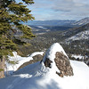 Snow-covered rock on the crest, overlooking Lake Tahoe.