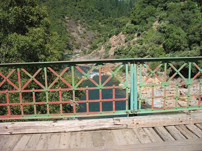 View downstream through the side rail on Edwards Crossing bridge.
