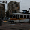 Passing Sac RT light rail train. Twin Towers State office buildings in background.