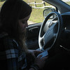 Melissa checks text messages one last time before putting the phone away for the drive home. A fun day out and about.