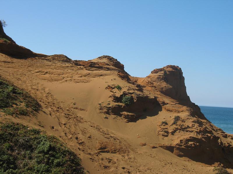 Sand on top of granite bedrock.