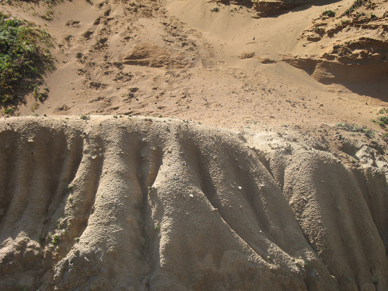 Eroded sand and mud.