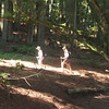 Jewel and Cheryl hiking through the redwood grove on Red Hill.