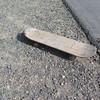 Abandoned skateboard by levee trail.