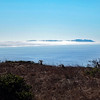 Fog-shrouded Point Reyes to the south.