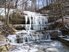 The falls are still frozen but not as much as a week ago.  Even at today's 24 degrees, water ran freely down the icicles.