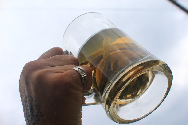 Herbal tea in Shri Yantra-tattooed Pavlio's hand