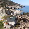 The coast of Milos is ringed by sea caves and small inlets that provide tiny hidden beaches.