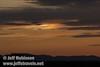 Sandhill cranes flying against sunset colors with a sun dog (10/4/2009, Isenberg Sandhill Crane Reserve near Lodi, CA)