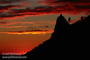 The red glow and clouds of the setting sun against a silhouetted ridge with spire and trees (11/2/2013, Wrights Rd.)<br /> EF70-200mm f/2.8L IS II USM @ 190mm f8 1/256s ISO100