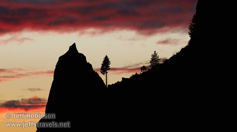 Red sunset clouds over a silhouetted ridge with a spire and trees (11/2/2013, Wrights Rd.)<br /> EF100-400mm f/4.5-5.6L IS USM @ 260mm f8 1/166s ISO400