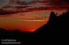 The red glow and clouds of the setting sun against a silhouetted ridge with spire and trees (11/2/2013, Wrights Rd.)<br /> EF70-200mm f/2.8L IS II USM @ 130mm f8 1/256s ISO100