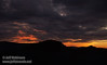 Pink and orange sunset colors over the silhouetted mountain and under mostly-grey clouds (11/2/2013, Wrights Rd.)<br /> EF24-105mm f/4L IS USM @ 70mm f5.7 1/128s ISO400