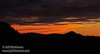 Pink and orange sunset colors over the silhouetted mountain and under mostly-grey clouds (11/2/2013, Wrights Rd.)<br /> EF100-400mm f/4.5-5.6L IS USM @ 170mm f7 1/332s ISO1600