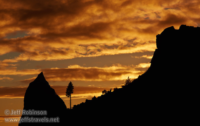 A brilliant-orange sunset behind a silhouetted tree and spire on a mountain (11/2/2013, Wrights Rd.)<br /> EF100-400mm f/4.5-5.6L IS USM @ 260mm f8 1/790s ISO100