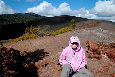 Alison sitting on the lava flow