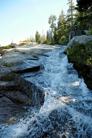 Creek flowing over granite slabs