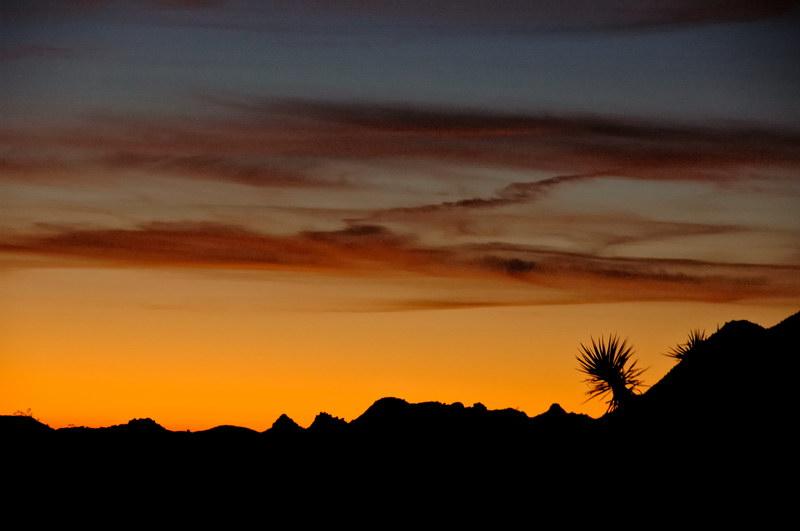Glowing sky behind the Granite Mountains
