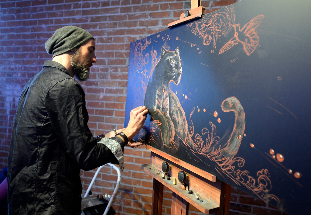 """. Bryce Widom does his chalk art during the dance party.  People were able to \""""dance with reckless abandon for two hours before work,\"""" according to organizers.  The Daybreaker Fire + Ice workout  was held at the  Boulder Museum of Contemporary Art on February 15, 2017. For more photos and a video, go to www.dailycamera.com.  Cliff Grassmick  Staff Photographer  February 15, 2017"""