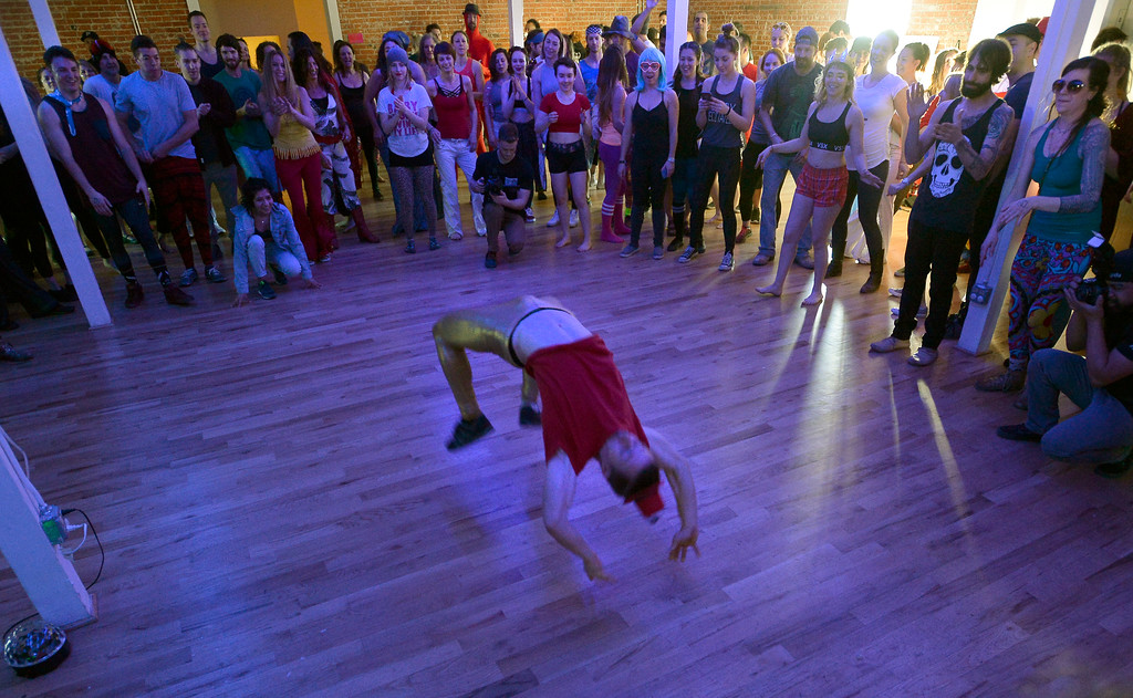 """. A few of the more extreme dancers dance in a circle of people.  People were able to \""""dance with reckless abandon for two hours before work,\"""" according to organizers.  The Daybreaker Fire + Ice workout  was held at the  Boulder Museum of Contemporary Art on February 15, 2017. For more photos and a video, go to www.dailycamera.com.  Cliff Grassmick  Staff Photographer  February 15, 2017"""