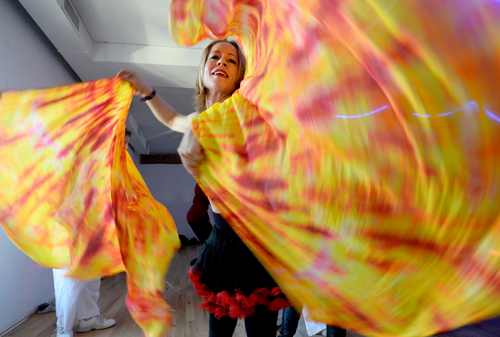""". Leanne Goff dances with the scarfs at the party.  People were able to \""""dance with reckless abandon for two hours before work,\"""" according to organizers.  The Daybreaker Fire + Ice workout  was held at the  Boulder Museum of Contemporary Art on February 15, 2017. For more photos and a video, go to www.dailycamera.com.  Cliff Grassmick  Staff Photographer  February 15, 2017"""