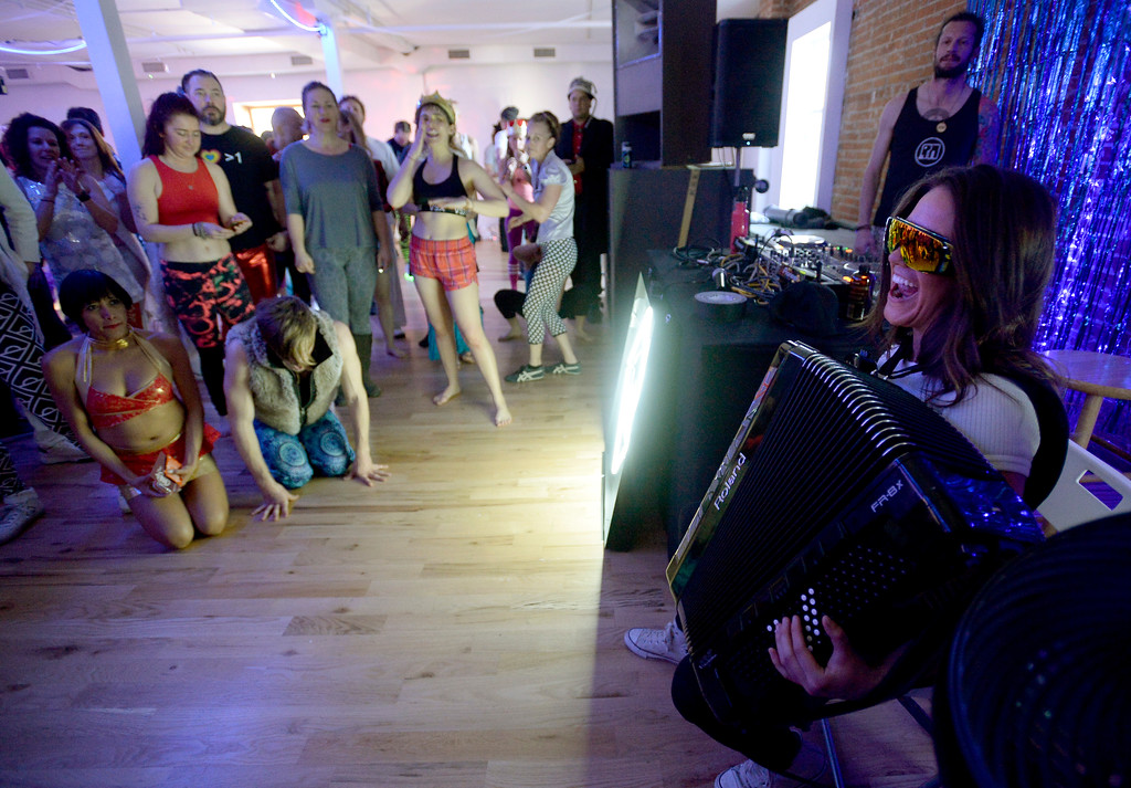 ". Alicia Baker, right, plays according with the dance music.  People were able to ""dance with reckless abandon for two hours before work,\"" according to organizers.  The Daybreaker Fire + Ice workout  was held at the  Boulder Museum of Contemporary Art on February 15, 2017. For more photos and a video, go to www.dailycamera.com.  Cliff Grassmick  Staff Photographer  February 15, 2017"