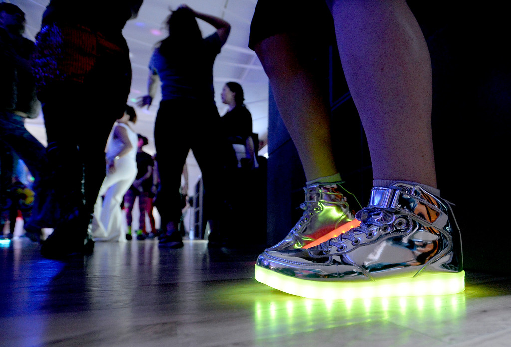 """. William Drake has lights in his shoes for dancing.  People were able to \""""dance with reckless abandon for two hours before work,\"""" according to organizers.  The Daybreaker Fire + Ice workout  was held at the  Boulder Museum of Contemporary Art on February 15, 2017. For more photos and a video, go to www.dailycamera.com.  Cliff Grassmick  Staff Photographer  February 15, 2017"""
