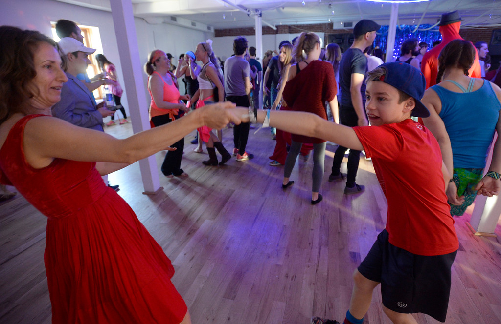 """. Mara Rose and her son, David Bray, looked like experienced dancers.  People were able to \""""dance with reckless abandon for two hours before work,\"""" according to organizers.  The Daybreaker Fire + Ice workout  was held at the  Boulder Museum of Contemporary Art on February 15, 2017. For more photos and a video, go to www.dailycamera.com.  Cliff Grassmick  Staff Photographer  February 15, 2017"""