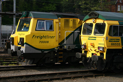 A contrast in noses and paint schemes! GE's 70008 and EMDs 66533 at Ipswich at Freightliner's Ipswich stabling point on the 18th April 2011