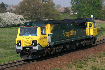 70008 drops down the bank to Felixstowe North light engine on the 18th April 2011