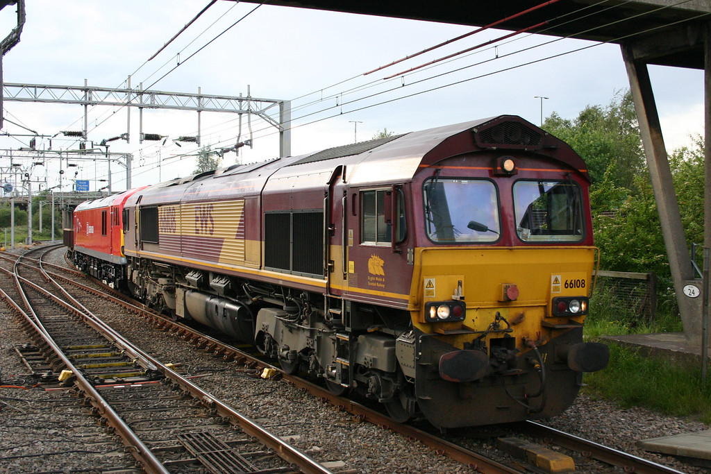 Freshly repainted in eye-popping DB Schenker red 92042 arrives at Bescot as part (in fact most!) of the consist of the 6G45 Toton - Bescot departmental, in the company of 66108 and MHA 'coalfish' 394602. 10th June 2011.