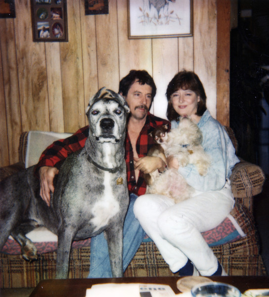 My dad, aunt, and our dogs. I don't know the year.