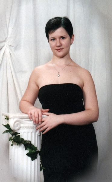 My senior-year roommate, Cat. This was her senior portrait, I believe. Year 2000.